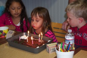 Blowing out her candles on her 6th birthday.
