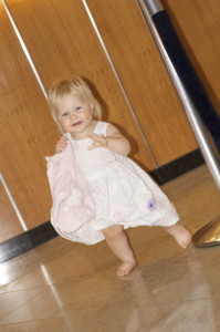 In the lobby of our hotel. She was so good in her stroller this was her release. She was so cute .. and happy.. and fast. You can see why we got so many comments on her. This was one of my favorite dresses on Jennifer. She actually wore it in the maternity photo shoot we did when I was expecting Jonathan. I dont know what I am going to do when she wants to pick her own clothes...  I love putting her in Jennifer's things.. or something that connects my girls.