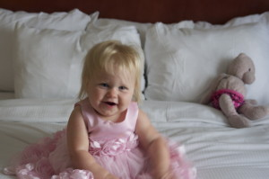 baby Charlotte looked adorable in the flower girl dress that both girls wore.. I knew she wont fit in it for much longer so I chose it for our visit to the Hill. On the bed with pinkie behind her .. I took so many pictures..