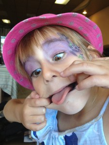 *2 of her favorite things. face painting and making a face for the camera*